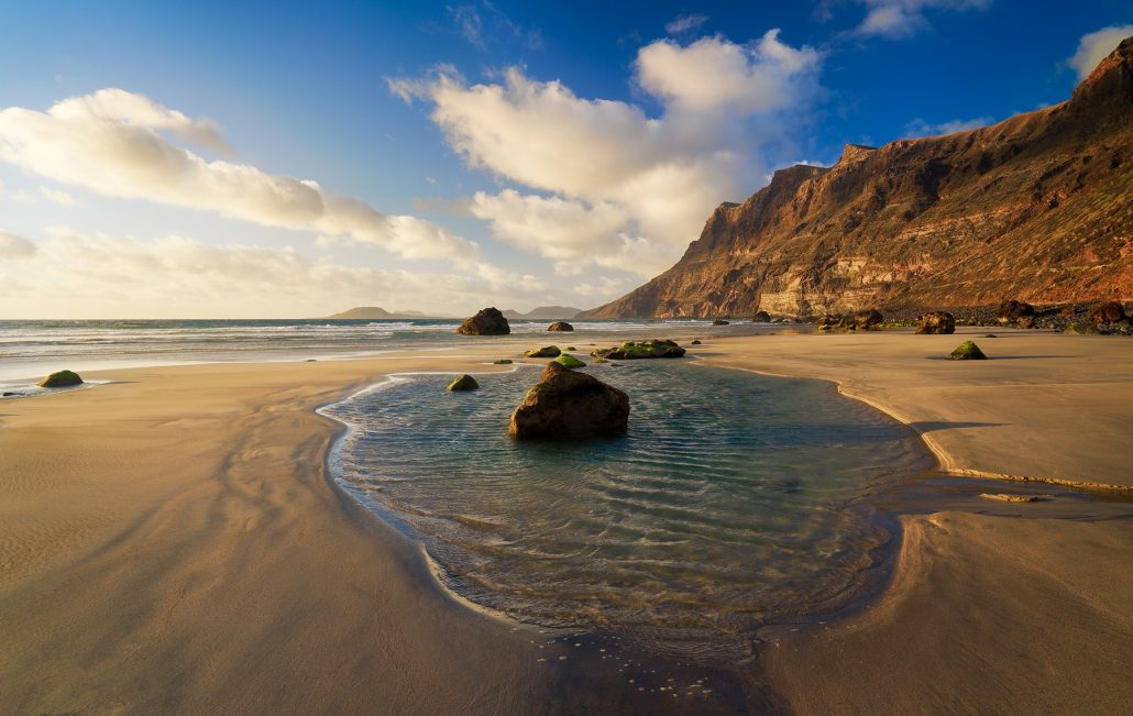 Landscape photo. Low tide at Famara beach. Lanzarote