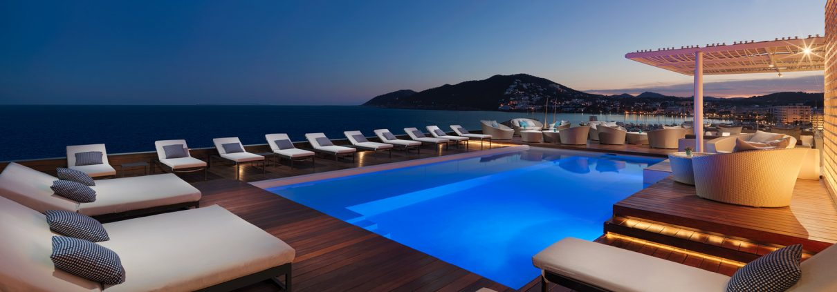 Rooftop pool at sunset photograph