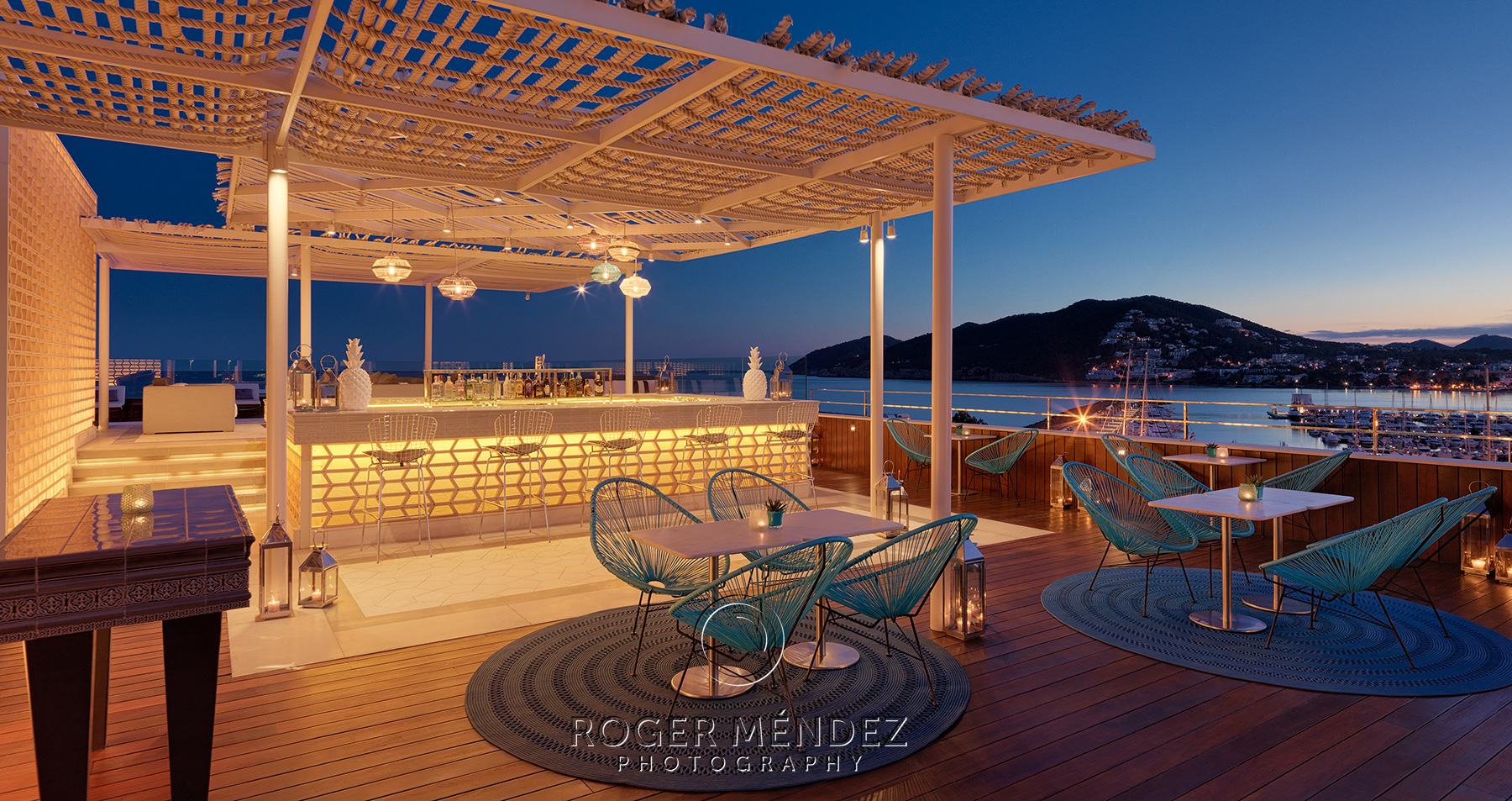 Rooftop pool bar at sunset