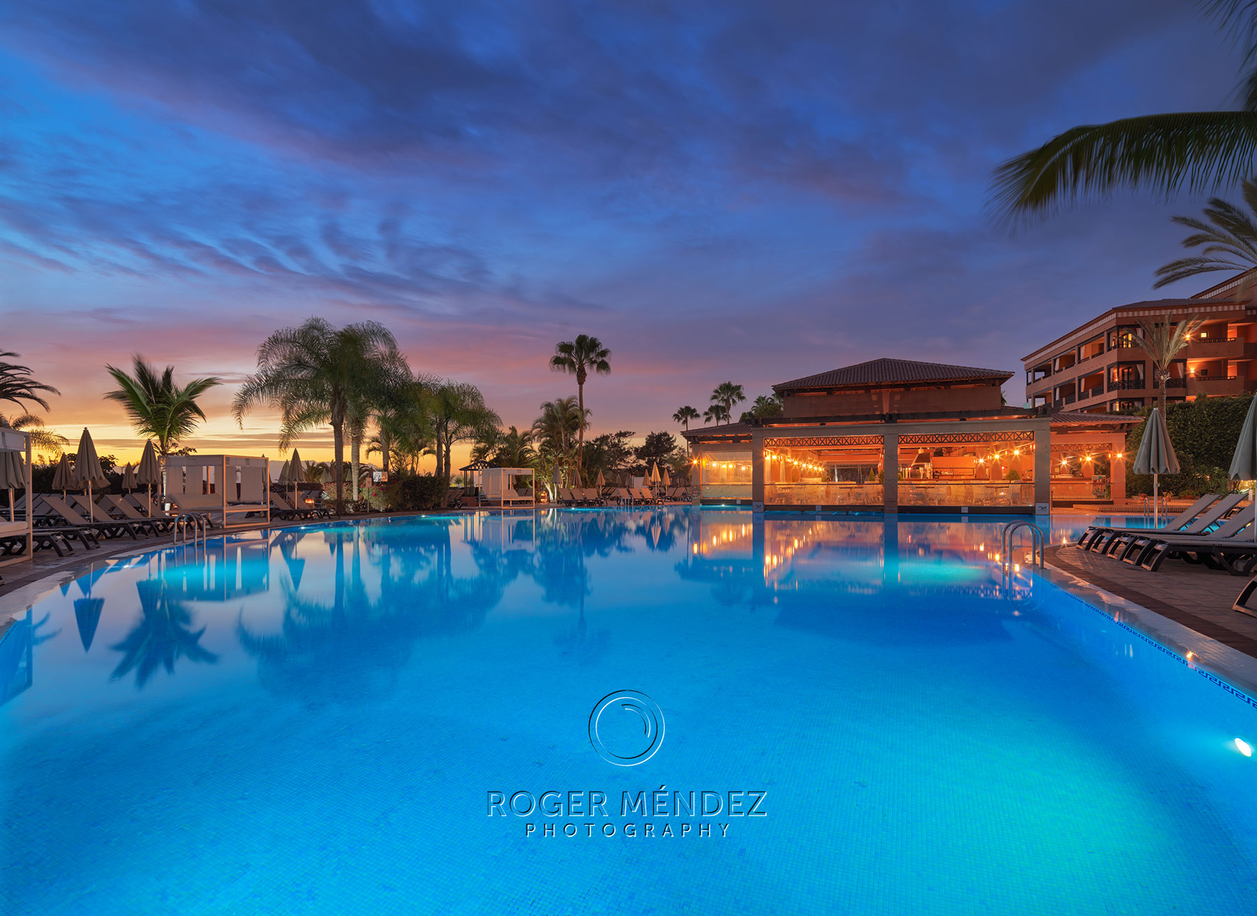 Main swimming pool at sunset