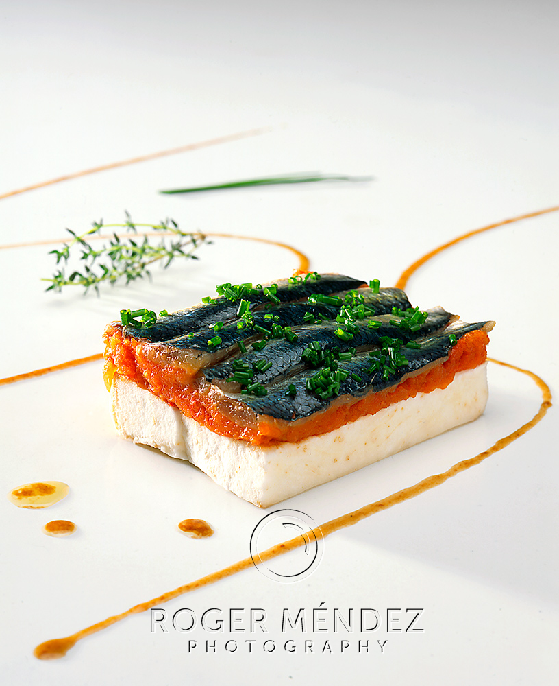 Roasted sardines on tomato and sweet potato